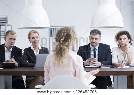 Headhunters Examining A Potential Employee During Job Recruitment In Corporation