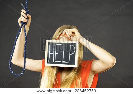 Suicidal Unrecognizable Skinny Woman Having Face Help Sign On Dark Board Next To Hanging Rope With K