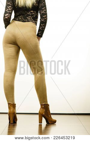 Rear View Of Fit Woman In Leggins. Fashion Concept.