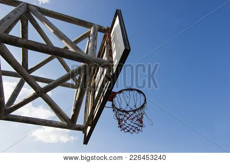 Old Wooden Basketball Hoop With Blue Sky Background