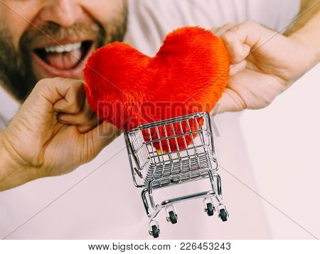 Man Holding Shopping Basket Cart With Red Heart. Love, Valentines Day, Charity Sharing Concept.