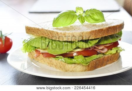 Club Sandwich With Ham And Cheese, Close-up Shot. Delicious Turkey And Salad Sandwich Or Toast With