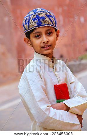Agra, India - November 8: Unidentified Boy Stands Near The Wall Of Taj Mahal Complex On November 8,