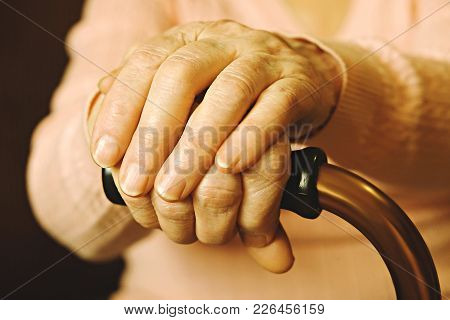 Close Up Of Mature Womans Hands. Health Care Giving, Nursing Home. Parental Love Of Grandmother. Old