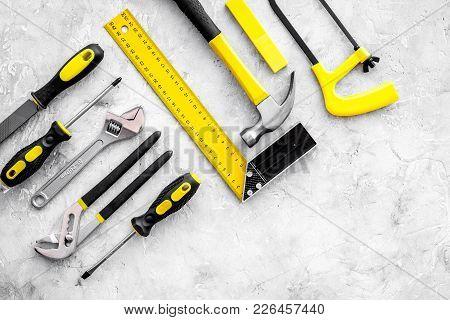 Repair Tools. File, Hummer, Corner Ruler On Grey Background Top View Copy Space Pattern.