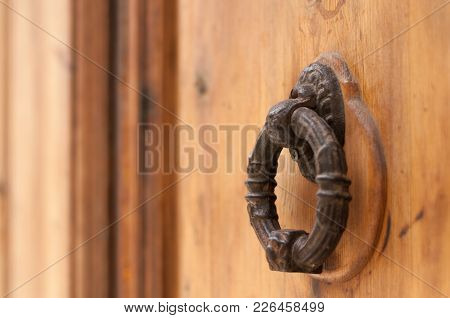 Ancient Iron Door Knocker On Medieval House