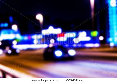 Night City View In Blur. City Speed Traffic Blurry Photo. Street Life Bokeh Image. Street View With