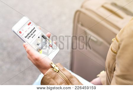 Woman Search Holiday Apartments And Rooms Online With Mobile Phone. Vacation Home Rental Website Or