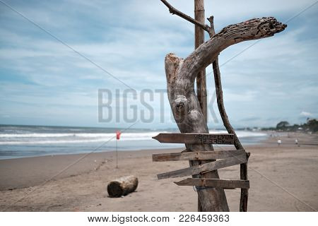 Empty Signage Of City Distance At The Beach. Concept Of Travelling Around The World