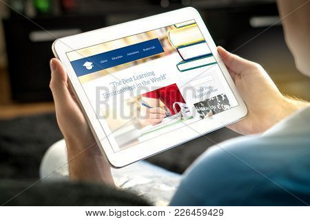 School Website On Tablet Screen. Young Man And Applicant Browsing College Or University Websites Bef