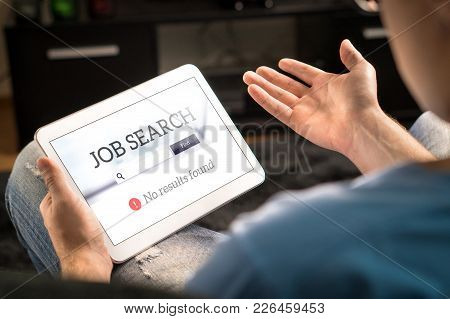 Unemployment And Job Search Problem. Unhappy And Frustrated Man Can't Find Work With Tablet. No Resu