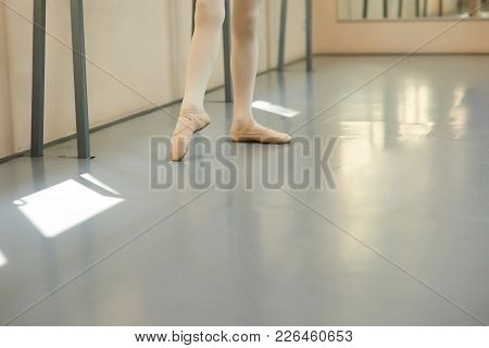 Legs Of Young Ballerina, Cropped Image. Young Ballet-dancer At Ballet Hall. Classical Ballet Studio.