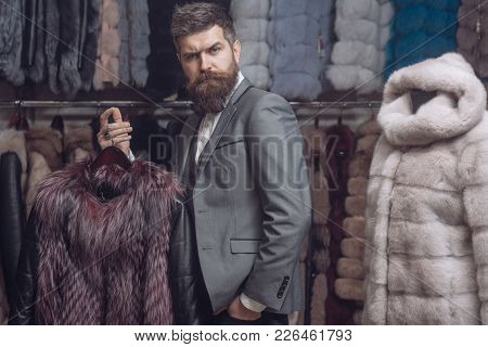 Businessman With Expensive Overcoat. Guy With Beard Buys Furry Coat. Fashion And Shopping Concept. M