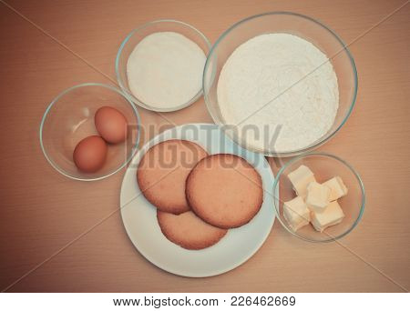 Baking Kitchen Ingredients And Prepared Cookies On Table. Top View.