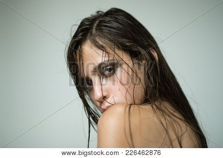 Woman With Wet Or Oily Hair On Grey Background. Girl With Makeup Face Skin And Naked Shoulders. Skin