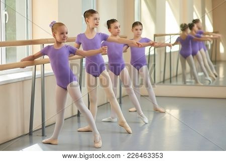 Young Ballerinas Having Rehearsal At Ballet School. Pretty Young Ballet Dancers Training At Ballet B