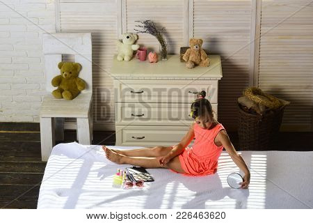 Beauty And Fashion Concept. Kid With Makeup Accessories In Childroom. Little Girl With Curlers Wears