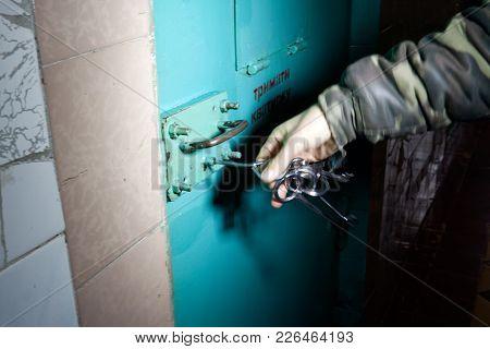 Kharkiv, Ukraine - October 26, 2017: The Prison Guard Unlocks The Camera Door аt The Kharkiv Peniten