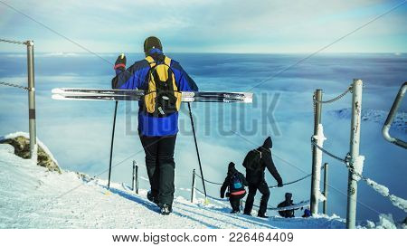 Man Carrying Cross-country Skiing Descends From The Mountain.. Man With Cross-country Skiing In The