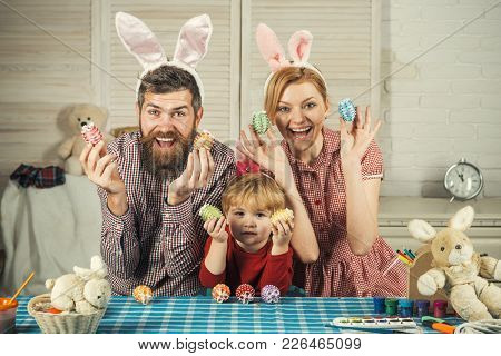 Family Values, Childhood, Art. Easter, Mother, Father And Child In Bunny Ears. Happy Family Celebrat