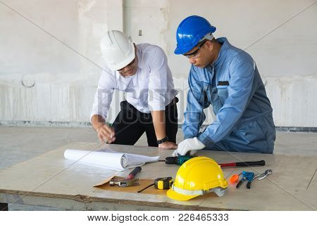 Project Manager Supervisor Foreman Or Architect Discuss With Technical Engineer Or Civil Worker Over