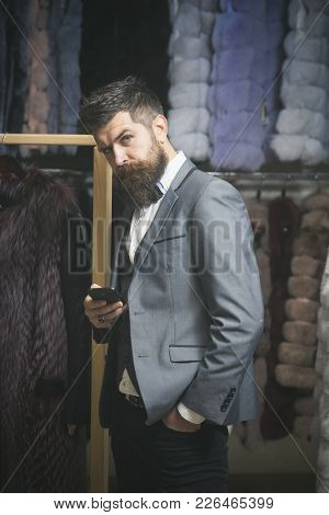 Macho With Stylish Appearance With Fur In Fashion Store. Man With Beard And Mustache At Fur Coat. Gu