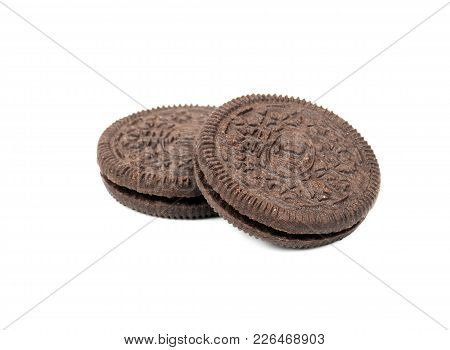 Tasty Black Cookies With Cream Isolated On White Background