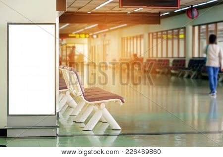 Mock Up Of Vertical Blank Advertising Billboard Or Light Box Showcase With People Walking At Airport
