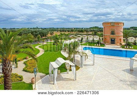 Fasano, Italy - August 29, 2006: The Garden And Pool Of The St. George Resort, One Of The Ancient Ru