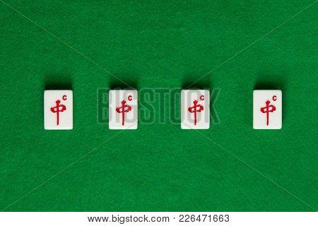 White-green Tiles For Mahjong On Green Cloth. 4 Dragons