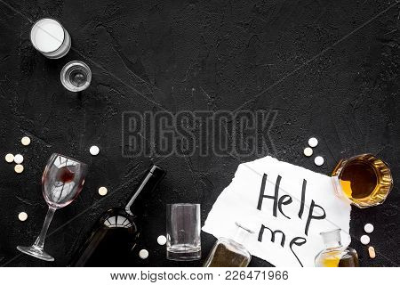 Treat Alcohol Dependence. Words Help Me Near Glasses, Bottles And Pills On Black Background Top View