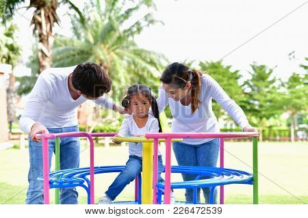Family Concept. Happy Male And Female Playing With Children Outside. Family Is Doing Happy Activitie