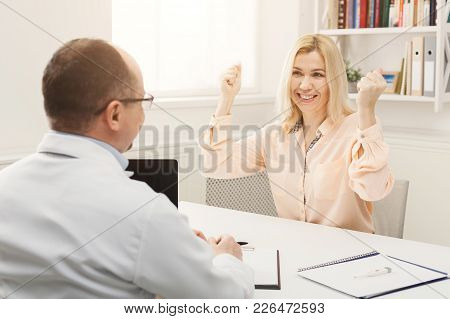 Doctor Consulting And Telling Good News To The Woman, Healthcare And Medical Concept, Copy Space