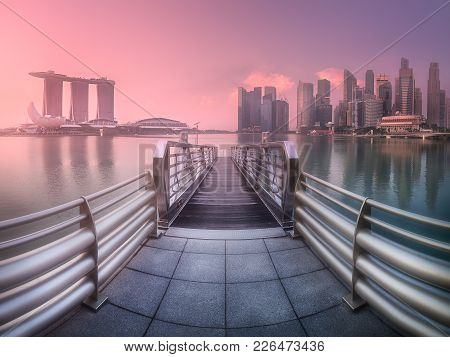 View Of Downtown District And Skyline Of Singapore From Pier With Chrome Handrails