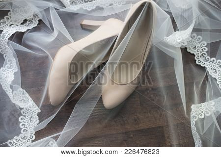 Beige Bridal Shoes Are Covered With A Veil. Wedding Details.