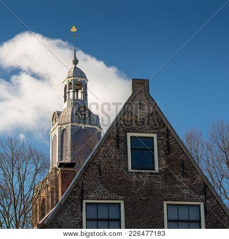 Church Tower Of The Grote Kerk In Vlaardingen Behind An Old House