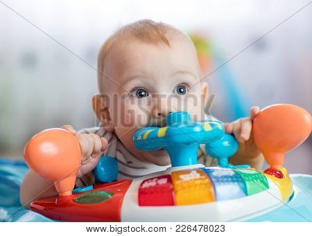 Funny Baby Boy Biting Toy In Jumper