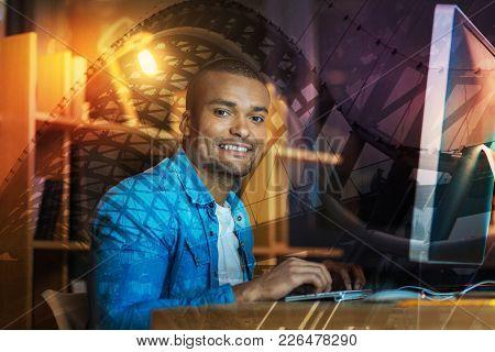 Joyful Mood. Smart Experienced Creative Translator Sitting With His Fingers On The Keyboard And Feel