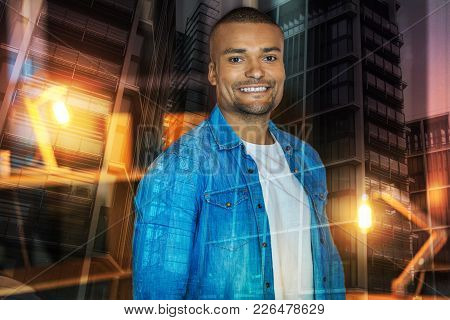 Confident Man. Cheerful Emotional Young Man Smiling And Looking Confident While Being Photographed B