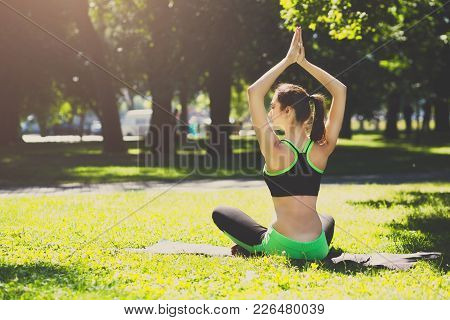 Fitness, Woman Yoga Relax Meditation In Lotus Pose Outdoors, Back View. Young Slim Girl Makes Exerci