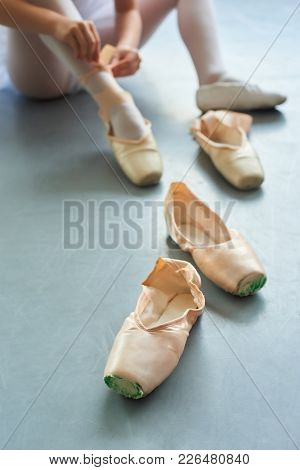 Pair Of Ballet Pointe Shoes. Female Slippers For Ballet Dance, Blurred Background. School Of Classic
