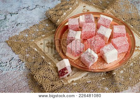 Turkish Sweets On A Round Copper Tray On An Openwork Napkin.