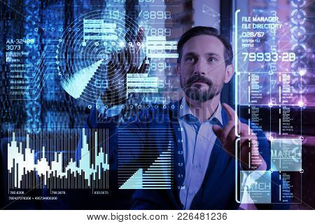 Important Data. Smart Experienced Skilled Programmer Feeling Confident While Standing In Front Of A