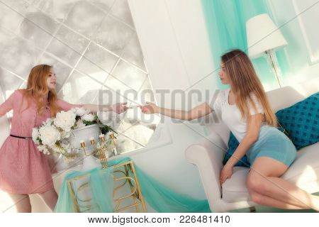 Fashion Interior Photo Of Two Beautiful Young Girls With Light Hair