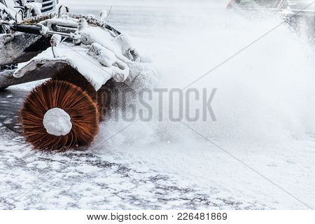 Snow Blowing Machine Works Outdoor After Heavy Snowstrom. Excavator On Winter Day. Tractor Removes S