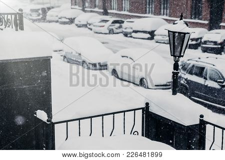 Driving In Snow. Cars Covered With Snow Stand In Parking Lot, Being Paralysed Because Of Bad Weather