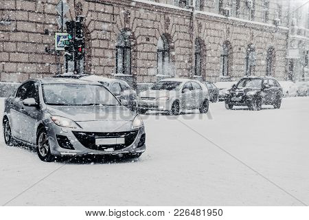 Cars Ride On Green Traffic Light, During Heavy Snowfall. Deep Snow After Blizzard. Winter Trafic, Ba