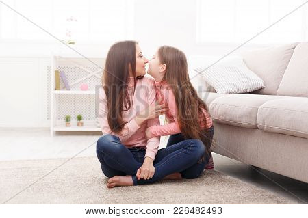 Mother With Her Cute Little Daughter Sitting On The Floor. Mothers Day, Relationship, Motherhood, Jo