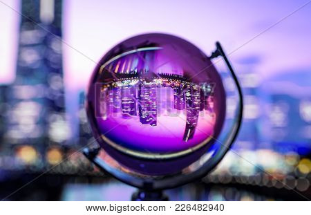 Crystal Globe With Blur Background And Reflection Of Cityscape Inside