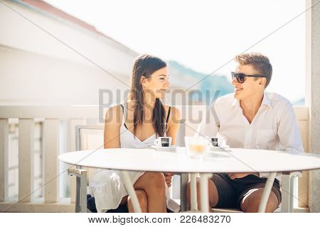 Attractive Couple Having First Date.blind Date.coffee With A Friend.smiling Happy People Having A Co